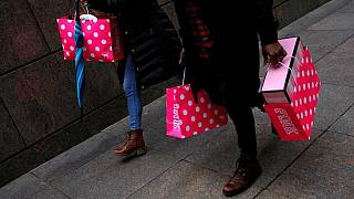 U.S. consumer spending rises; monthly inflation rebounds