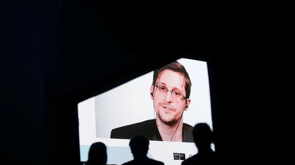 Snowden says democracy under threat by attacks on 'fake news'