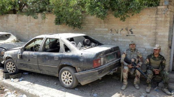 De retour à Mossoul, des habitants cherchent désespérément leur voiture