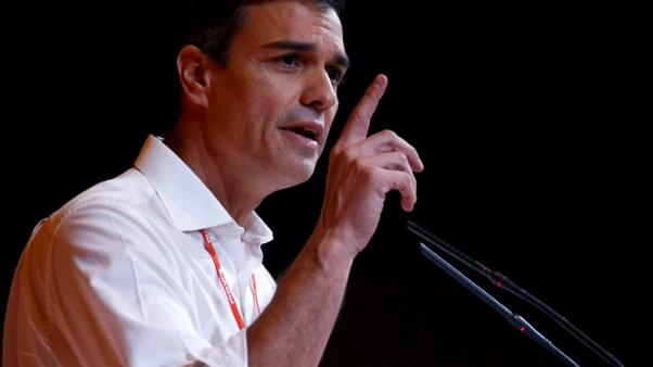 Spanish Socialists crown new leader as clash with PM Rajoy looms