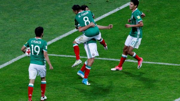 Football - Mexico come from behind to beat New Zealand 2-1