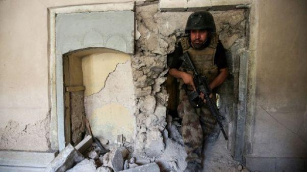 A Mossoul, les balles sifflent encore autour de la mosquée al-Nouri libérée