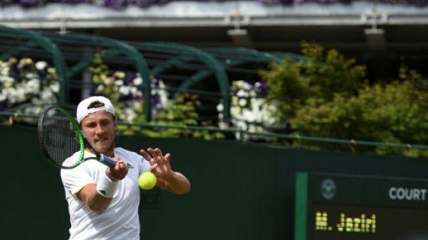 Wimbledon: Pouille accroché mais au deuxième tour