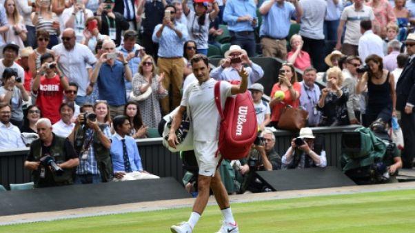 Wimbledon: Federer remporte (par abandon) son 85e match, record battu