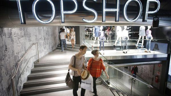 Australia's Myer cuts profit guidance, writes off Topshop, shares slump