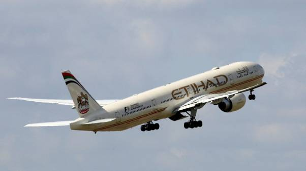 Etihad Airways sells first airline stake since launching review