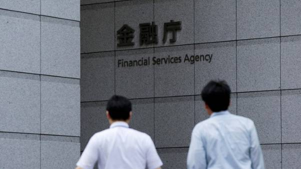 Japan regulator warns small banks they must change to survive