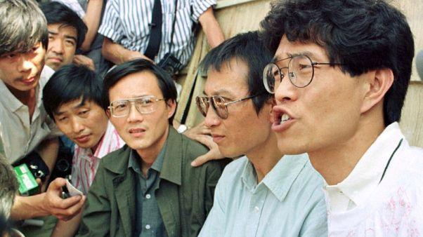 Surviving Tiananmen 'Gentlemen' mum on Chinese Nobel laureate's death