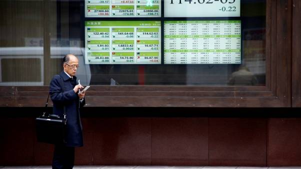 Dollar falls, U.S. bond prices rise as Fed tone mildly dovish
