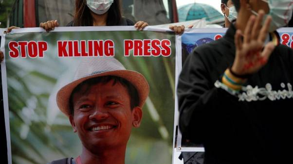 Detained Myanmar journalists defiant at 'unlawful association' trial