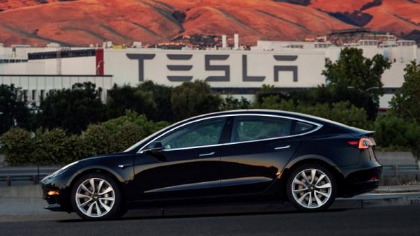 Tesla climbs as Musk prepares to hand over first Model 3 cars