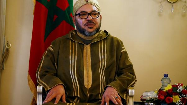 Morocco's king pardons some protesters, lambasts officials