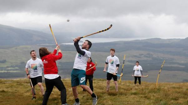 Shinty game in the shadow of Ben Nevis showcases Scottish highlands
