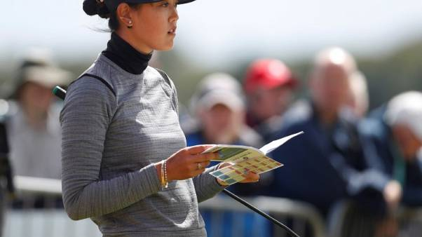 Wie fires course record 64 to lead Women's British Open
