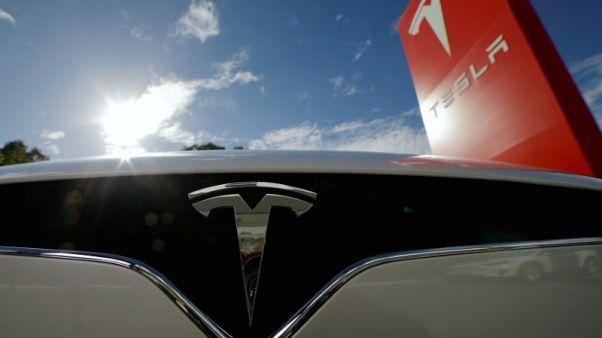 Tesla lowers price of Model X, saying margins improved
