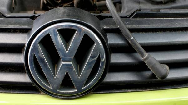 German state premier on defensive over close ties with VW
