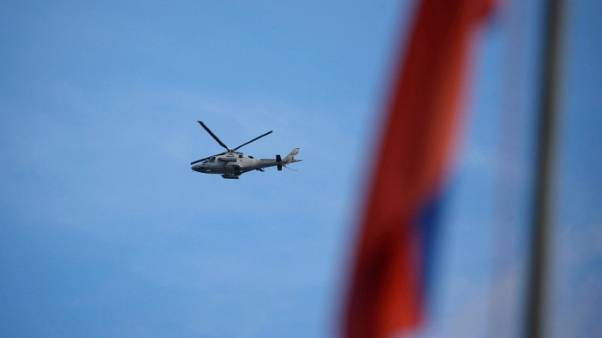Exclusive - Japan seeks South East Asia clout with chopper parts for Philippines military: sources