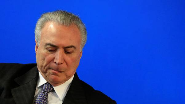 Brazil president weakened by graft charge, losing fiscal battle