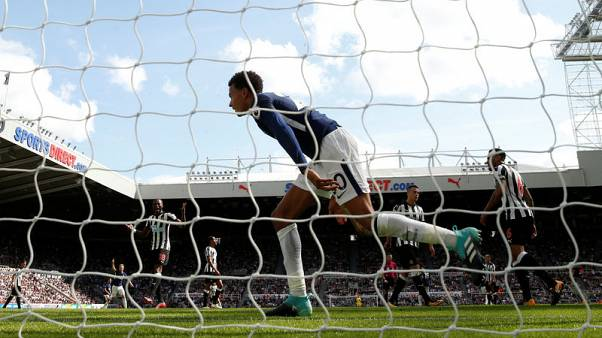 Alli and Davies give Spurs 2-0 win at 10-man Newcastle