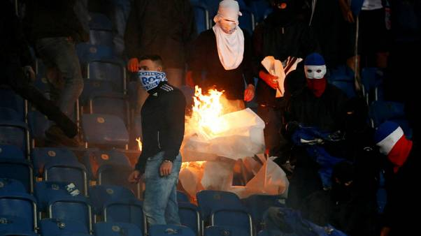 German minister calls for tough response to soccer violence