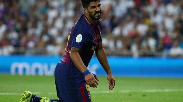 Barca problems mount with Suarez and Pique injuries