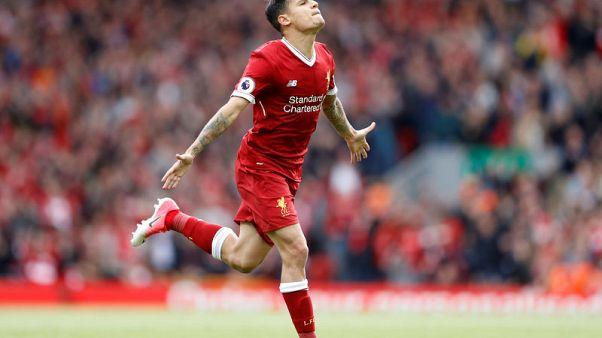 Liverpool's Coutinho still injured, no attitude problem, says Klopp