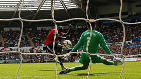 Man United rout Swansea with flurry of late goals