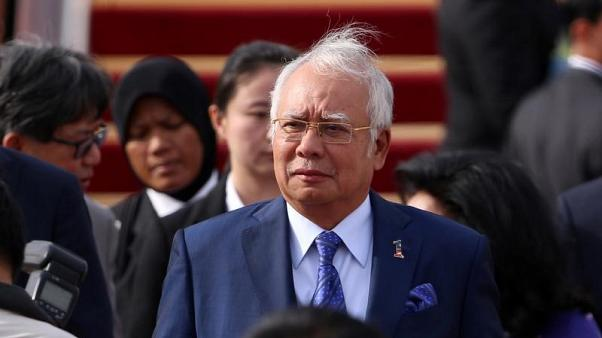 Trump plans to meet scandal-hit Malaysian leader in September - official