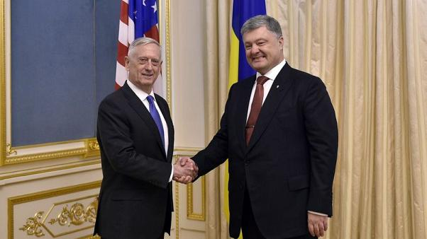 U.S. Defense Secretary says Russia trying to redraw borders by force