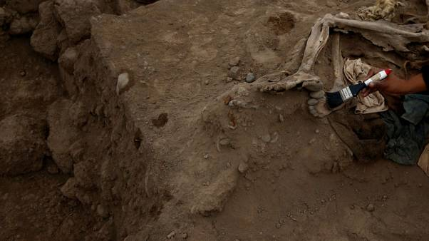 At ancient pyramid in Peru, remains of 20th century Chinese labourers found