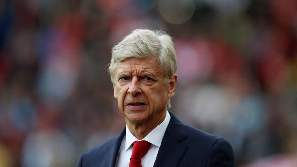 Liverpool to test Wenger's faith in three-man defence