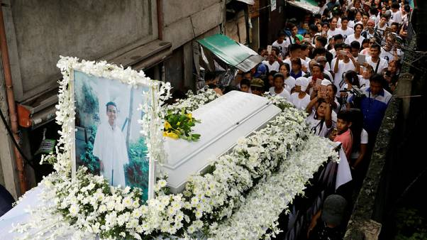 More than a thousand join funeral procession for slain Philippine teenager