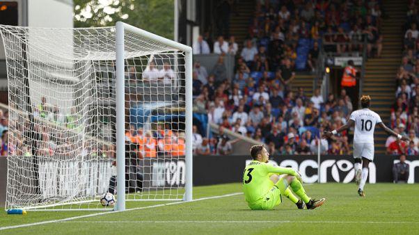 Abraham, Ayew score as Swansea sink Palace