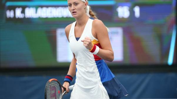 Mladenovic continues in free fall