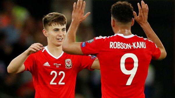 Teenager Woodburn's debut goal ignites Welsh hopes