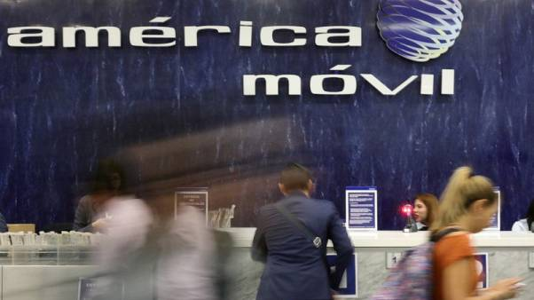 America Movil reaches deal to sell stake in soccer clubs