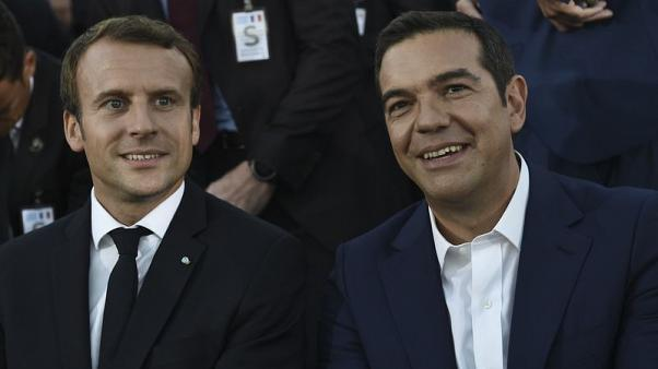 Greek hosts warm to Macron's euro zone vision