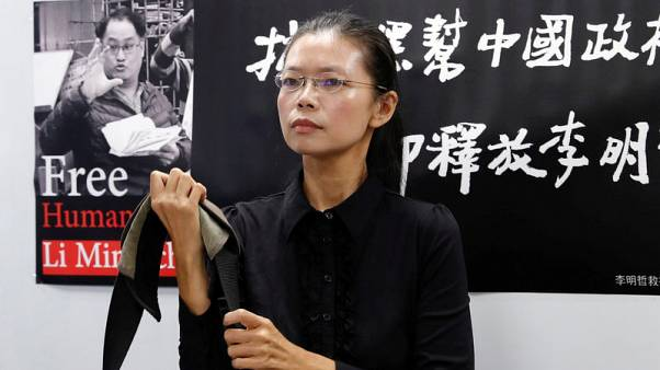 """Taiwan activist to be tried for subversion in China in """"open"""" hearing"""