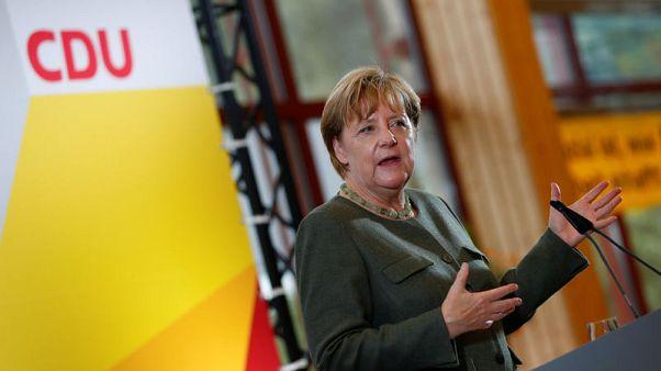 We'll lift Russia sanctions when east Ukraine is peaceful - Merkel