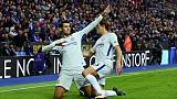 Chelsea roll on with 2-1 win at Leicester
