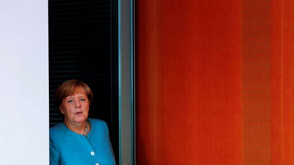 Turks safe in Germany, Merkel says, dismissing Ankara's warning