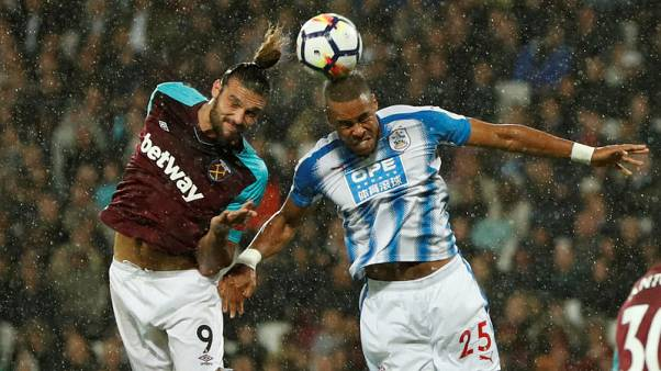 West Ham beat Huddersfield 2-0 to ease pressure on Bilic