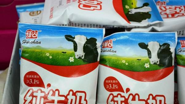 Huishan Dairy debt woes deepen as banks demand $220 million repayment