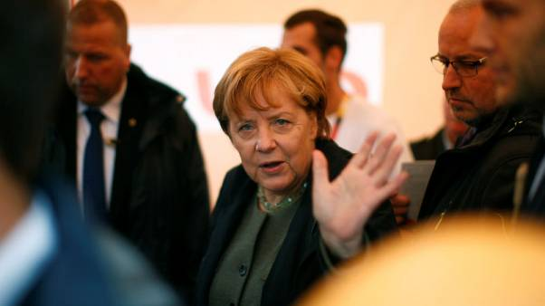 Germany's Merkel admits early cigarette as 'youthful sin'