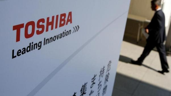 Toshiba signs memorandum to accelerate chip sale talks with Bain group
