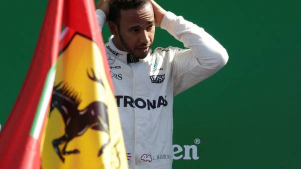 Hamilton chasing Singapore hat-trick but wary of Ferrari