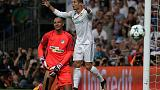 Ronaldo fires holders Real to easy victory over APOEL