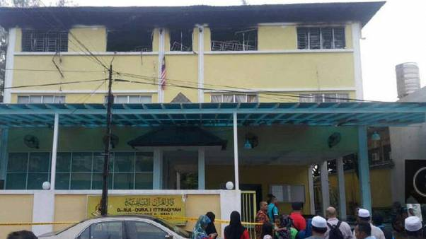Fire kills at least 25 at religious school in Malaysian capital - officials
