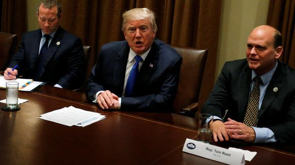 Trump says rich might pay more in taxes, talks with Democrats
