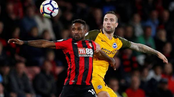 Bournemouth's Defoe strikes to seal comeback win over Brighton